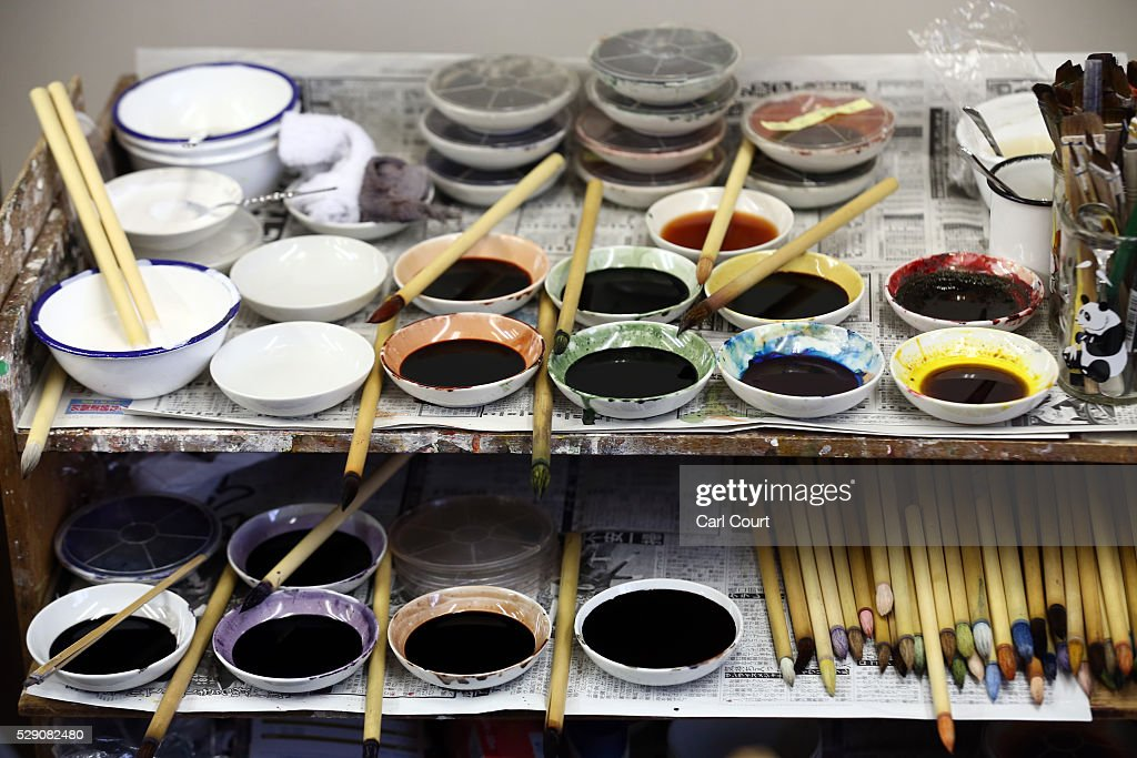 Dyes and brushes for colouring patterns on kimono fabric are placed on a shelf at the Sensyo Ichikawa kimono workshop on April 26 2016 in Kyoto Japan...