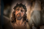 Dying Jesus with tongue bleeding from eyes and blurry background
