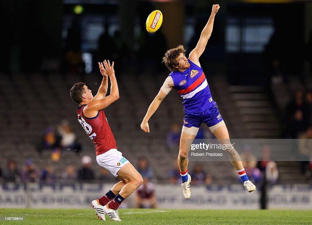Dylan Addison of the Bulldogs spoils during the round 13 AFL match between the Western Bulldogs and the Brisbane Lions at Etihad Stadium on June 23, 2012 in Melbourne, Australia.
