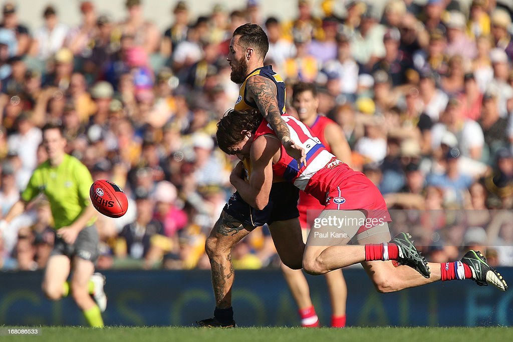 Dylan Addison of the Bulldogs tackles Chris Masten of the Eagles during the round six AFL match between the West Coast Eagles and the Western Bulldogs at Patersons Stadium on May 5, 2013 in Perth, Australia.