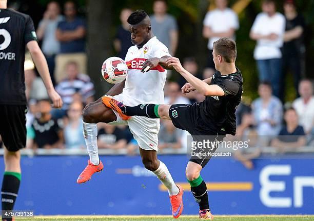 Dylan Akpess Esmel of Stuttgart is challenged by Maurice Springfeld of Hannover during the BJuniors Bundesliga semi final match between U17 VfB...