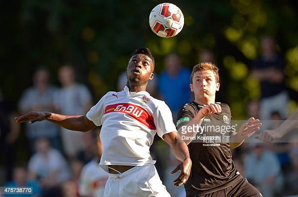 Dylan Akpess Esmel of Stuttgart jumps for a header with Nikita Marusenko of Hannover during the BJuniors Bundesliga semi final match between U17 VfB...