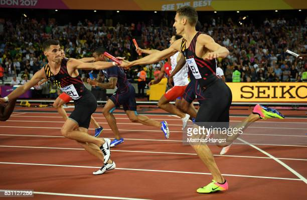 Dylan Borlee passes the baton to team mate Kevin Borlee of Belgium in the Men's 4x400 Metres Relay final during day ten of the 16th IAAF World...