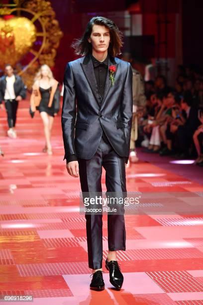 Dylan Brosnan walks the runway at the Dolce Gabbana show during Milan Men's Fashion Week Spring/Summer 2018 on June 17 2017 in Milan Italy