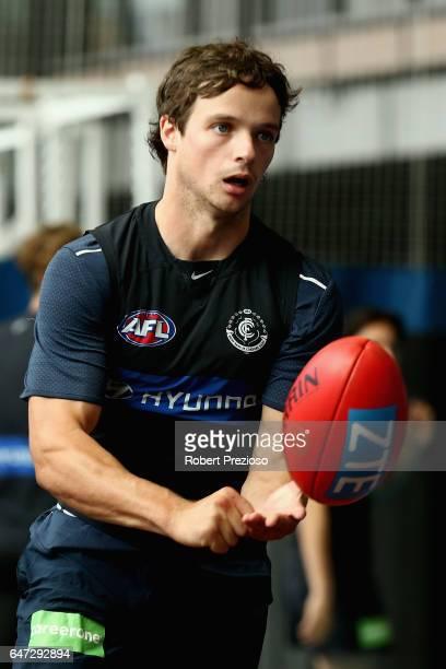 Dylan Buckley handballs during a Carlton Blues AFL media opportunity at Ikon Park on March 3 2017 in Melbourne Australia