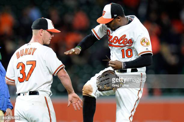 Dylan Bundy of the Baltimore Orioles celebrates with Adam Jones after throwing a complete game shutout against the Seattle Mariners at Oriole Park at...