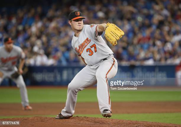 Dylan Bundy of the Baltimore Orioles delivers a pitch in the first inning during MLB game action against the Toronto Blue Jays at Rogers Centre on...