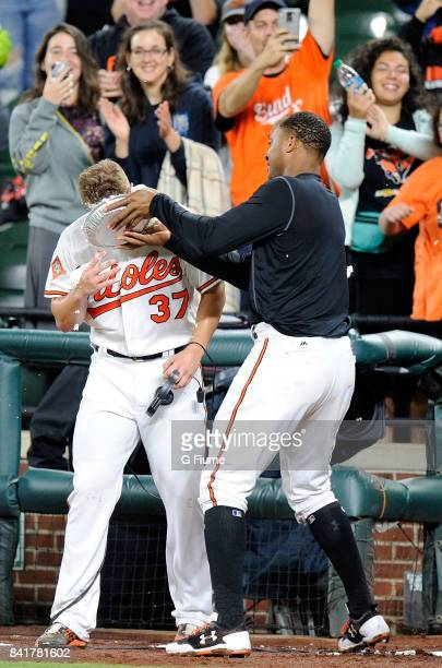 Dylan Bundy of the Baltimore Orioles gets pied by Jonathan Schoop after throwing a complete game shutout against the Seattle Mariners at Oriole Park...