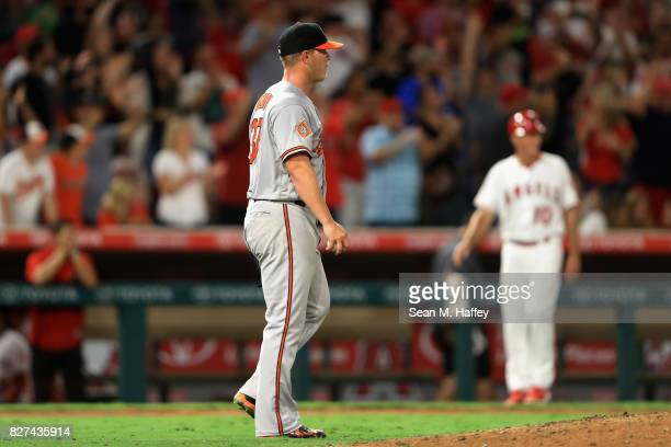 Dylan Bundy of the Baltimore Orioles looks on after allowing a solo homerun to Mike Trout of the Los Angeles Angels of Anaheim during the sixth...