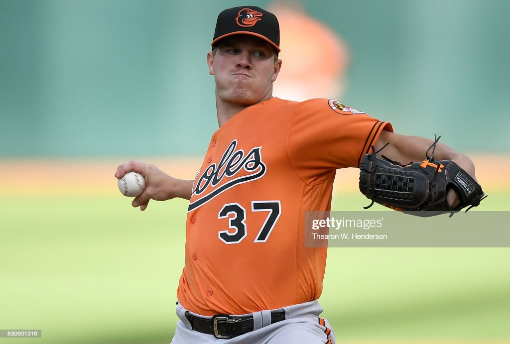 Dylan Bundy #37 of the Baltimore Orioles pitches against the Oakland Athletics in the bottom of the first inning at Oakland Alameda Coliseum on August 12, 2017 in Oakland, California.