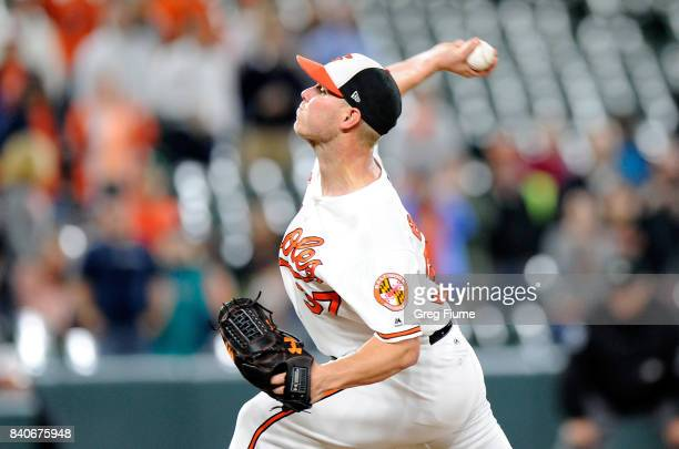 Dylan Bundy of the Baltimore Orioles pitches in the ninth inning against the Seattle Mariners at Oriole Park at Camden Yards on August 29 2017 in...