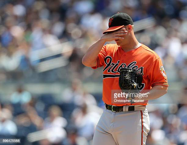 Dylan Bundy of the Baltimore Orioles reacts after walking Gary Sanchez of the New York Yankees during the bottom of the first inning against the New...