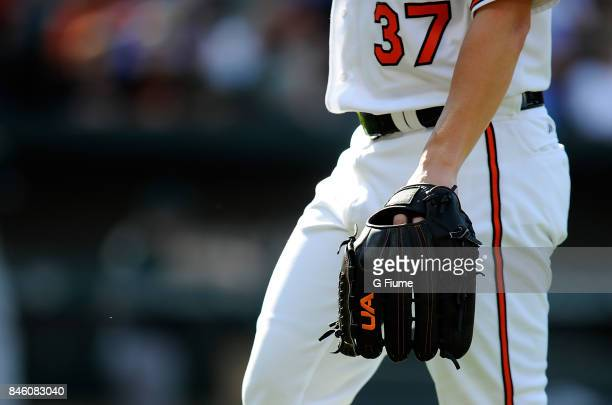 Dylan Bundy of the Baltimore Orioles uses an Under Armour glove during the game against the Oakland Athletics at Oriole Park at Camden Yards on...