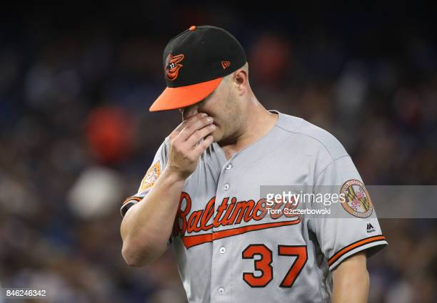 Dylan Bundy of the Baltimore Orioles walks off the mound towards the dugout after retiring the side in the fifth inning during MLB game action...