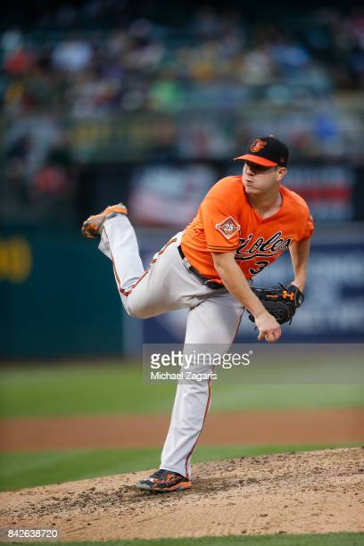 Dylan Bundy of the Baltimore Orioless pitches during the game against the Oakland Athletics at the Oakland Alameda Coliseum on August 11 2017 in...