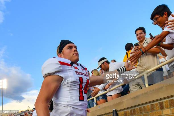 Dylan Cantrell of the Texas Tech Red Raiders interacts with fans before the game between the Texas Tech Red Raiders and the Arizona State Sun Devils...