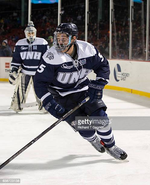 Dylan Chanter of the New Hampshire Wildcats skates against the Northeastern Huskies during NCAA hockey at Fenway Park during 'Frozen Fenway' on...