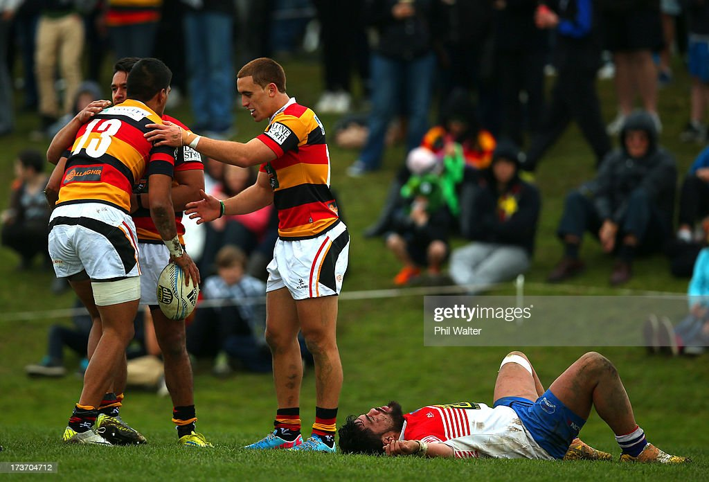 Dylan Collier of Waikato is congratulated on his try as Aaron Kearney of Horowhenua-Kapiti lies on the ground during the Ranfurly Shield match between Waikato and Horowhenua-Kapiti at the Morrinsville Domain on July 17, 2013 in Morrinsville, New Zealand.