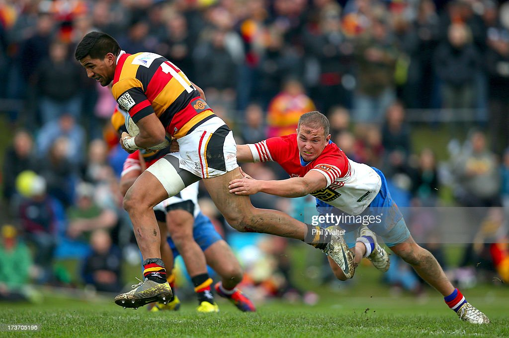 Dylan Collier of Waikato is tackled by Darryl Saunders-May of Horowhenua-Kapiti during the Ranfurly Shield match between Waikato and Horowhenua-Kapiti at the Morrinsville Domain on July 17, 2013 in Morrinsville, New Zealand.