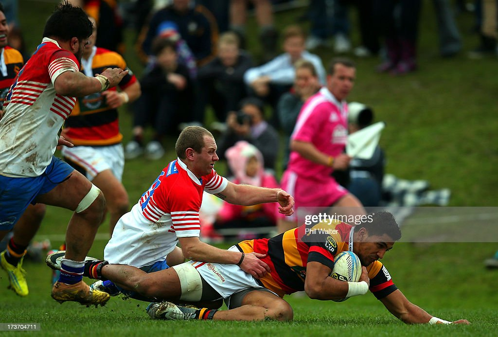 Dylan Collier of Waikato scores a try in the tackle of Darryl Saunders-May of Horowhenua-Kapiti during the Ranfurly Shield match between Waikato and Horowhenua-Kapiti at the Morrinsville Domain on July 17, 2013 in Morrinsville, New Zealand.