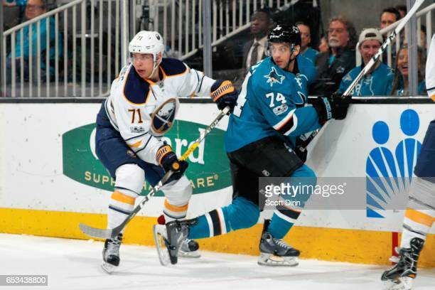 Dylan DeMelo of the San Jose Sharks and Evan Rodrigues of the Buffalo Sabres look on during a NHL game at SAP Center at San Jose on March 14 2017 in...