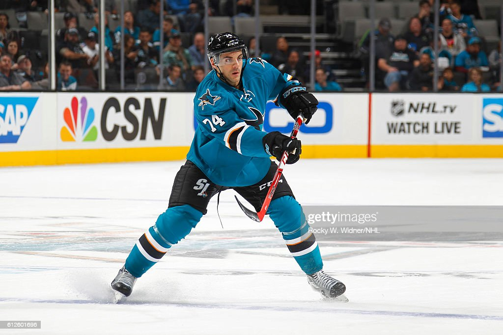 Dylan DeMelo #74 of the San Jose Sharks shoots the puck against the Arizona Coyotes at SAP Center on September 30, 2016 in San Jose, California.