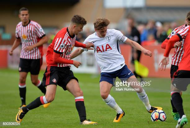 Dylan Duncan of Tottenham Hotspur is tackled by Ethan Robson of Sunderland during the Premier League 2 match between Sunderland and Tottenham Hotspur...