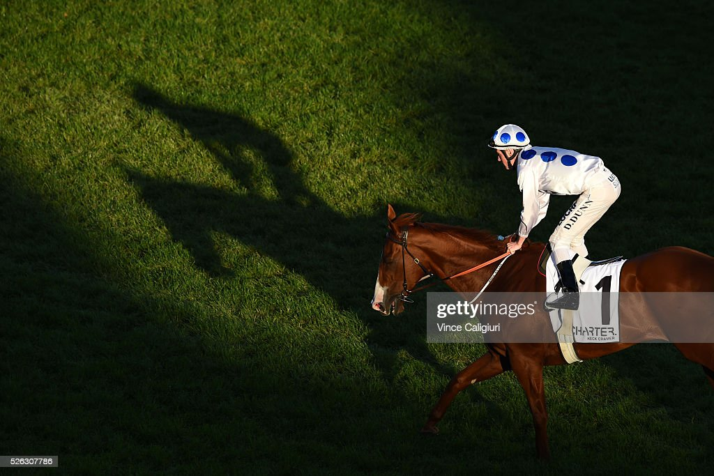 Dylan Dunn riding Charmed Harmony after winning Race 8 during Melbourne Racing at Caulfield Racecourse on April 30, 2016 in Melbourne, Australia.