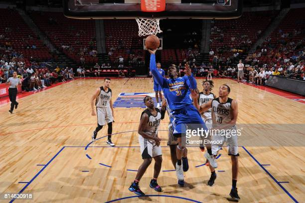 Dylan Ennis of the Golden State Warriors goes to the basket against the LA Clippers on July 14 2017 at the Thomas Mack Center in Las Vegas Nevada...
