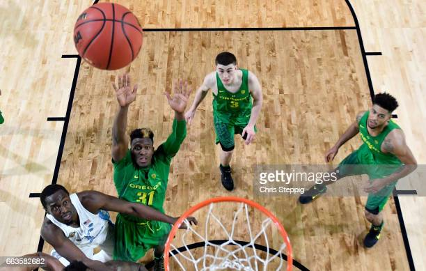 Dylan Ennis of the Oregon Ducks and Kennedy Meeks of the North Carolina Tar Heels look for a rebound during the 2017 NCAA Men's Final Four Semifinal...