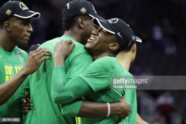 Dylan Ennis of the Oregon Ducks celebrates with teammates after defeating the Kansas Jayhawks 7460 during the 2017 NCAA Men's Basketball Tournament...