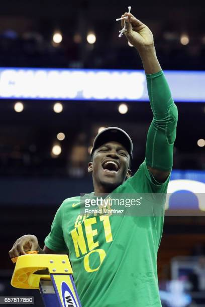 Dylan Ennis of the Oregon Ducks cuts the net after defeating the Kansas Jayhawks 7460 during the 2017 NCAA Men's Basketball Tournament Midwest...
