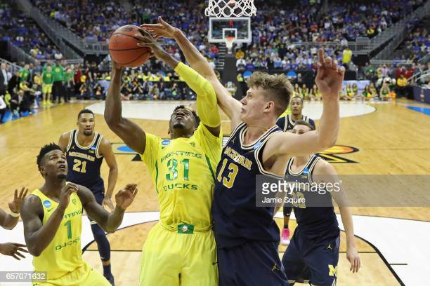 Dylan Ennis of the Oregon Ducks is defended by Moritz Wagner of the Michigan Wolverines during the 2017 NCAA Men's Basketball Tournament Midwest...