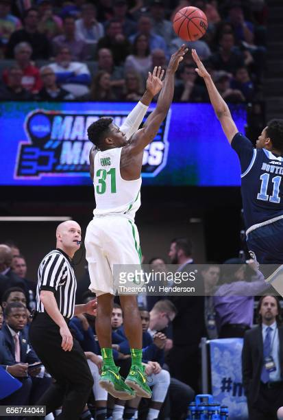 Dylan Ennis of the Oregon Ducks shoots over Jeff Dowtin of the Rhode Island Rams during the second round of the 2017 NCAA Men's Basketball Tournament...
