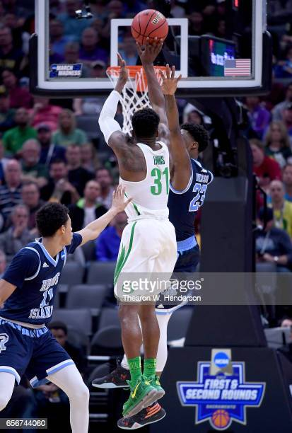 Dylan Ennis of the Oregon Ducks shoots over Kuran Iverson of the Rhode Island Rams during the second round of the 2017 NCAA Men's Basketball...