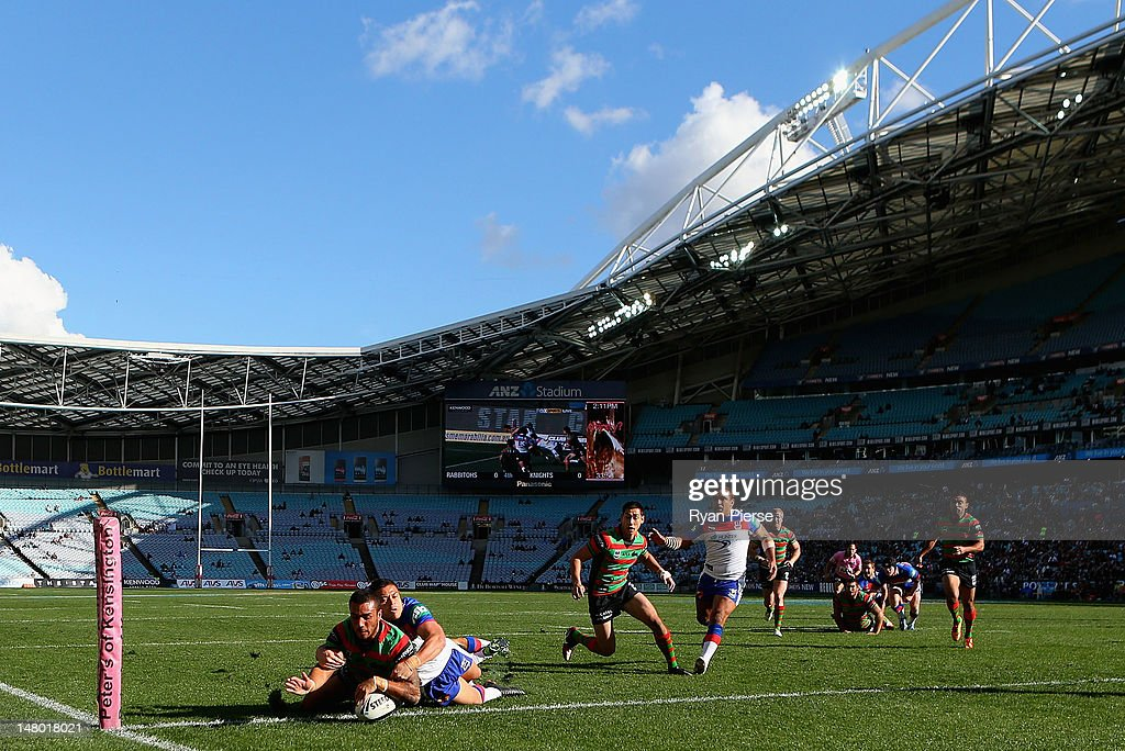 Dylan Farrell of the Rabbitohs crosses to score a try during the round 18 NRL match between the South Sydney Rabbitohs and the Newcastle Knights at ANZ Stadium on July 8, 2012 in Sydney, Australia.