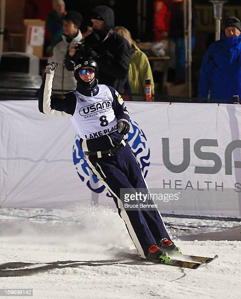 Dylan Ferguson of the USA celebrates his qualification jump in the USANA Freestyle World Cup aerial competition at the Lake Placid Olympic Jumping...