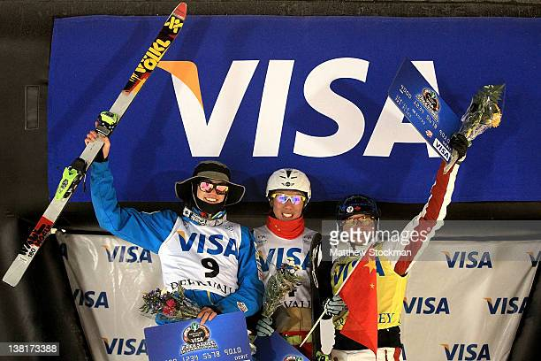 Dylan Ferguson Zongyang Jia of China and Olivier Rochon of Canada celebrate on the victory podium after Men's Aerials during the Visa Freestyle...