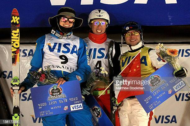 Dylan Ferguson Zongyang Jia of China and Olivier Rochon of Canada pose for photographers on the victory podium after Men's Aerials during the Visa...