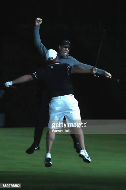Dylan Frittelli and George Coetzee of South Africa celebrate trying to set a new Guiness World Record for the fastest hole of golf ahead of the...