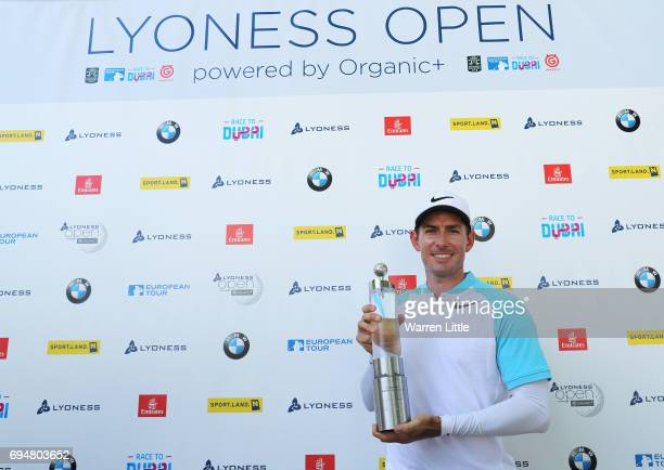 Dylan Frittelli of South Africa celebrates victory with the trophy after the final round on day four of the Lyoness Open at Diamond Country Club on...