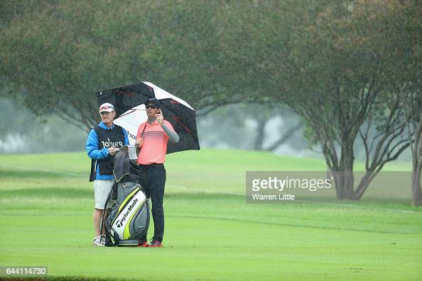 Dylan Frittelli of South Africa looks on as the rain falls on the 18th hole during the first round of the Joburg Open at Royal Johannesburg and...