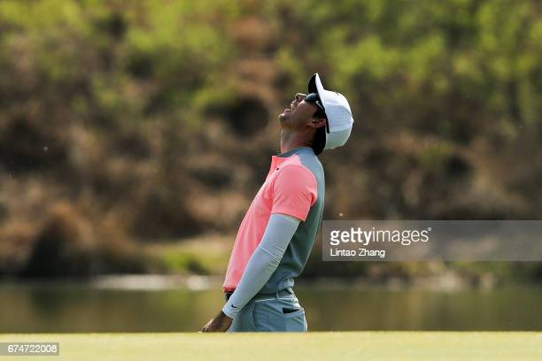 Dylan Frittelli of South Africa reacts after plays a shot during the third round of the 2017 Volvo China open at Topwin Golf and Country Club on...