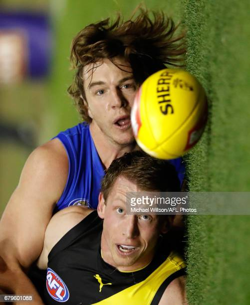Dylan Grimes of the Tigers and Liam Picken of the Bulldogs in action during the 2017 AFL round 07 match between the Western Bulldogs and the Richmond...