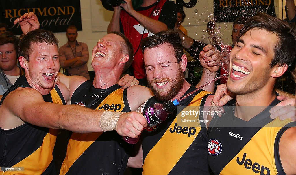 Dylan Grimes (L) of the Tigers celebrates the win with <a gi-track='captionPersonalityLinkClicked' href=/galleries/search?phrase=Jack+Riewoldt&family=editorial&specificpeople=2327975 ng-click='$event.stopPropagation()'>Jack Riewoldt</a>, Jake Batchelor and Alex Rance during the round two AFL match between the St Kilda Saints and the Richmond Tigers at Melbourne Cricket Ground on April 5, 2013 in Melbourne, Australia.