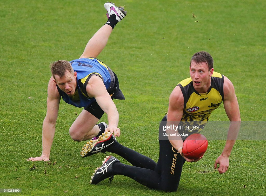 Dylan Grimes of the Tigers looks upfield from Jack Riewoldt during a Richmond Tigers AFL training session at Punt Road Oval on July 7 2016 in...
