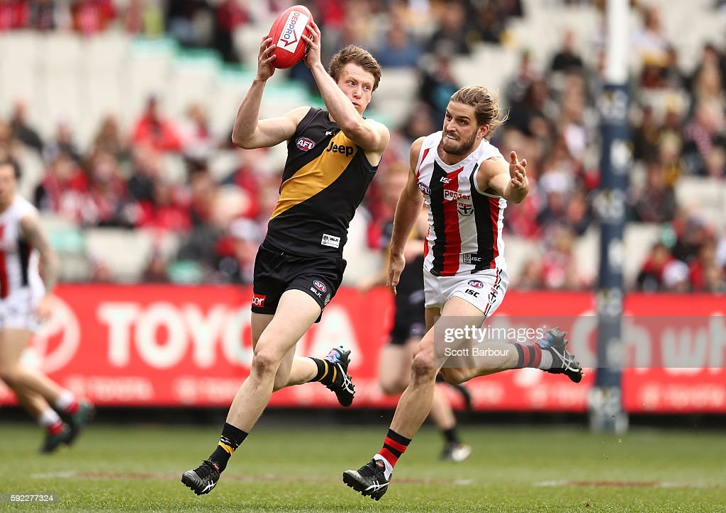 Dylan Grimes of the Tigers runs with the ball during the round 22 AFL match between the Richmond Tigers and the St Kilda Saints at Melbourne Cricket...