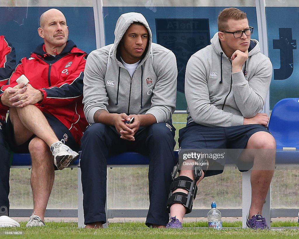 Dylan Hartley (R) and Courtney Lawes (C) sit out training with England physio Phil Pask during the England training session held at St Georges Park on October 29, 2012 in Burton-upon-Trent, England.