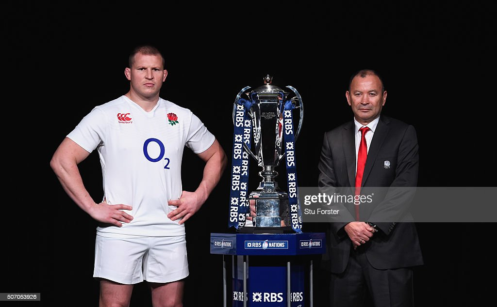 <a gi-track='captionPersonalityLinkClicked' href=/galleries/search?phrase=Dylan+Hartley&family=editorial&specificpeople=764177 ng-click='$event.stopPropagation()'>Dylan Hartley</a>, captain of England poses with head coach <a gi-track='captionPersonalityLinkClicked' href=/galleries/search?phrase=Eddie+Jones+-+Rugby+Coach&family=editorial&specificpeople=13966519 ng-click='$event.stopPropagation()'>Eddie Jones</a> and the trophy during the RBS Six Nations launch at The Hurlingham Club on January 27, 2016 in London, England.