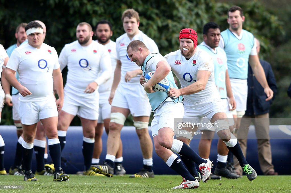 <a gi-track='captionPersonalityLinkClicked' href=/galleries/search?phrase=Dylan+Hartley&family=editorial&specificpeople=764177 ng-click='$event.stopPropagation()'>Dylan Hartley</a> charges upfield past <a gi-track='captionPersonalityLinkClicked' href=/galleries/search?phrase=James+Haskell&family=editorial&specificpeople=539694 ng-click='$event.stopPropagation()'>James Haskell</a> during the England training session held at Pennyhill Park on February 12, 2016 in Bagshot, England.